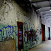 graffiti'd corridor in an abandoned factory