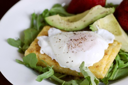 fried polenta on a bed of arugula