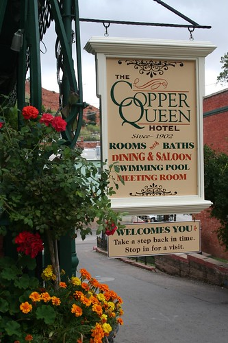Copper queen sign with flowers