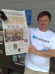 Mark Graham showing off the front page of the Mercury News (local newspaper showing me getting my iPhone)