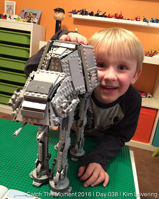 Henry posing with finished AT-AT lego