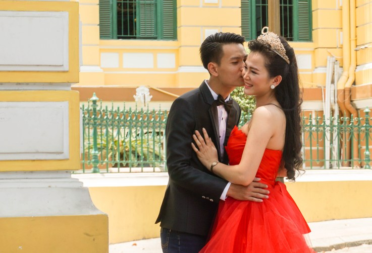 Young Couple Photo Shoot, Probably for Their Wedding, in Frront of the Saigon Central Post Office. Ho Chi Minh City, Vietnam, April 2016