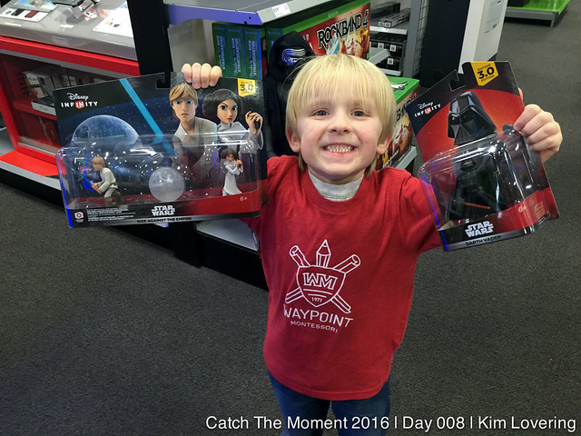 {8 of 366} Photo of Henry holding up new Disney infinity characters