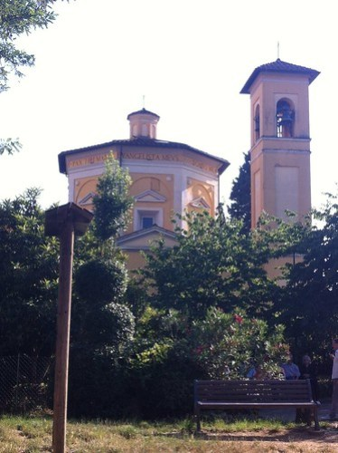 The local church in le cure, its yellow and white bell tower overlooking the children playground