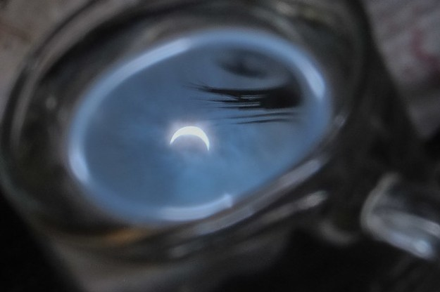Solar Eclipse in a Glass of Water, Saparua, Maluku