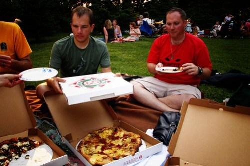 enjoying pizza at the farm