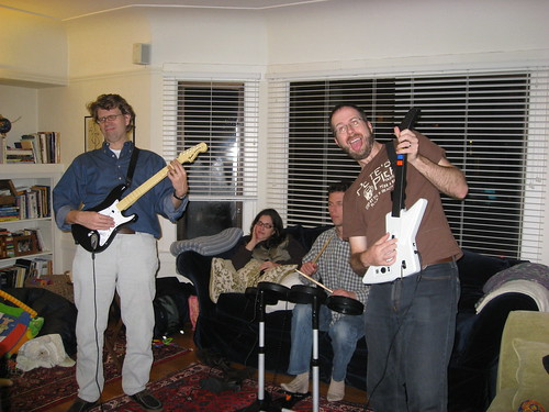 Peter, Ron, and JT playing Rock Band