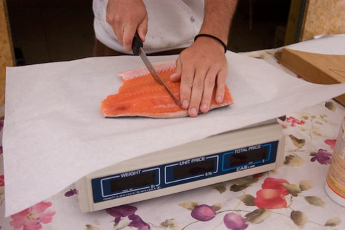 Thomas cuts the salmon