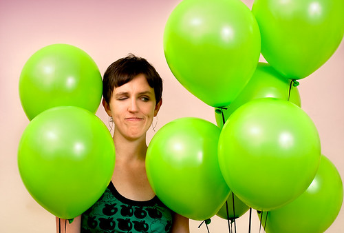 The green balloons get up close and personal