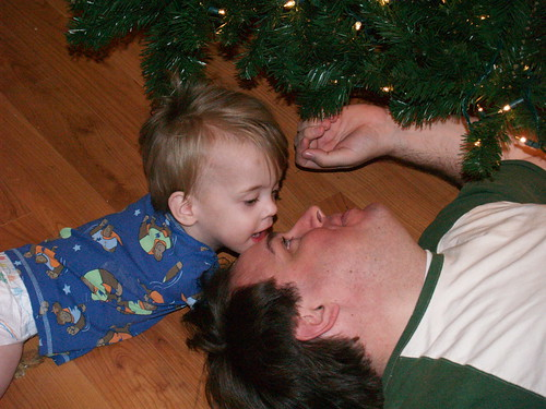 Baby and Dad setting up the Christmas Tree