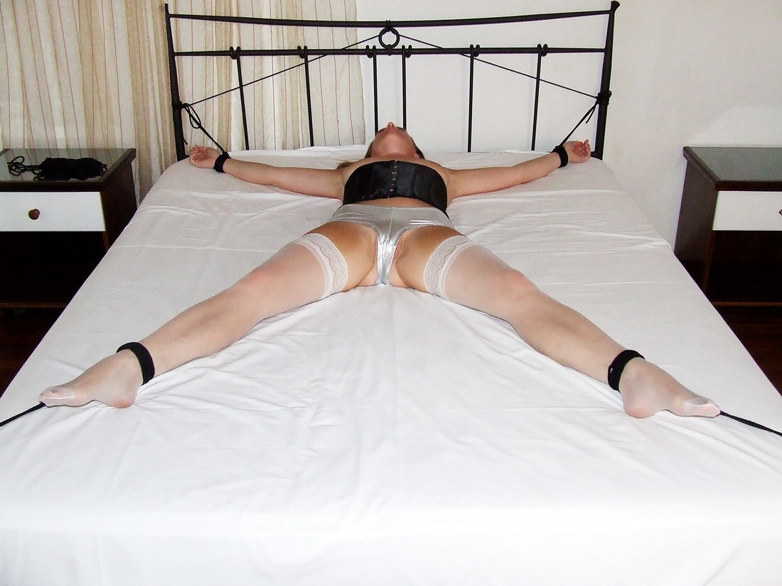 wife spread eagle on bed
