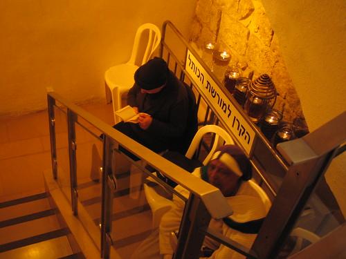 Women praying below stairs