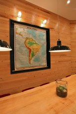 Map of South America at big communal table
