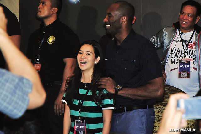 Kobe Bryant with Rappler's Multimedia reporter, Natashya Gutierrez after the Walang Iwanan Manila 2013 press conference.