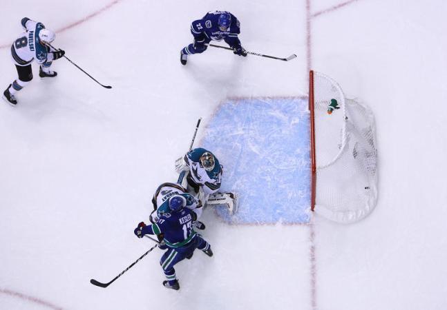 Antti Niemi can't stop Bieksa's opportunistic point shot.