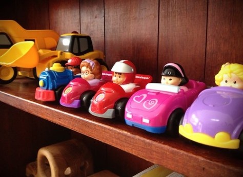 Fisher Price Little People Toy Cars on a shelf