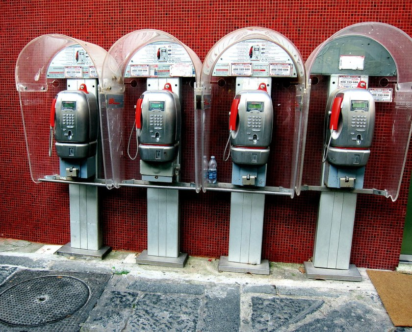 Forgotten but not gone, the old robot-like Italian pay phones are everywhere though we never saw anyone using them.