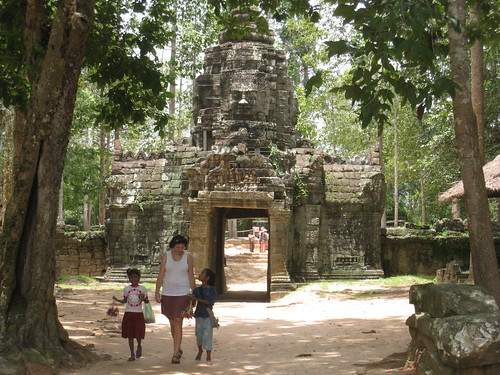 A few local kids following Alice outside a temple
