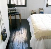 Painted black floors.   Door Sixteen