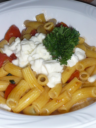 Homemade maccheroni with tomato and buffalo mozarella