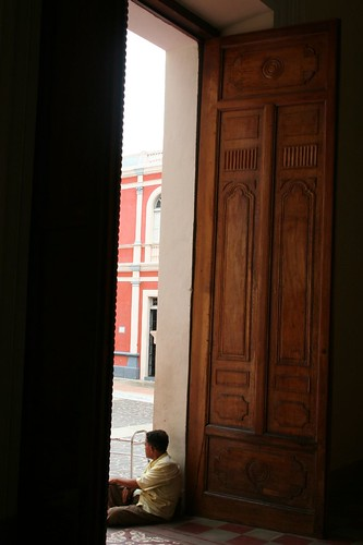Man waiting by the central door in Granada church