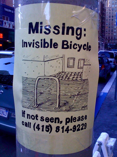 Sign on post: Missing Invisible Bicycle