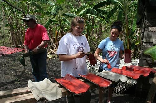 Volunteers painting tile