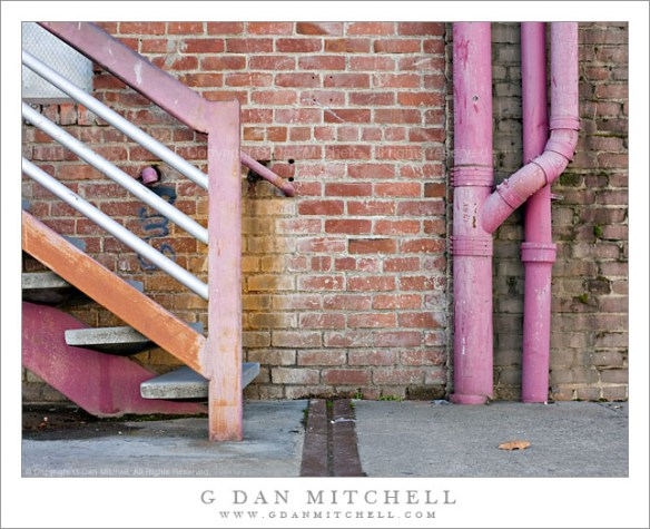 Brick Wall, Pipes, and Stairway
