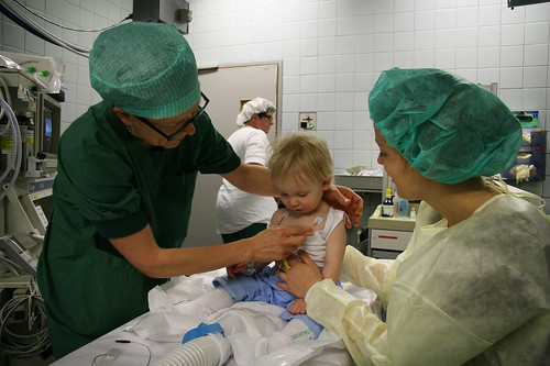 Getting wired on the operating table (Mom to the right)