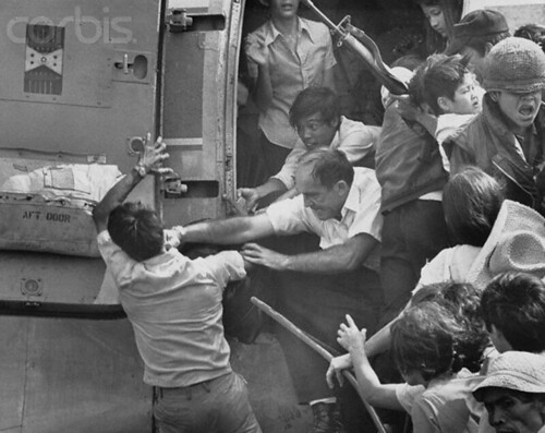 02 Apr 1975, Nha Trang, South Vietnam --- An American official punches a man in the face trying to break him from the doorway of an airplane already overloaded with refugees seeking to flee Nha Trang. --- Image by © Bettmann/CORBIS