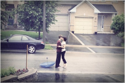 Young Couple Kiss in the Rain