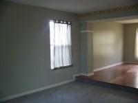 Standing in living room, dining room floor is raised ...