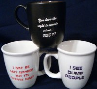 another group of coffee cups with different sayings on ...