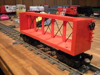 red centerbeam flatcar