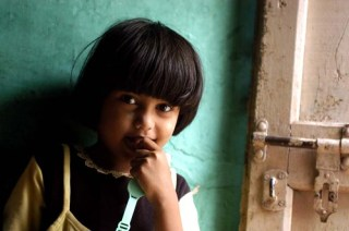 Children Reading Pratham Books and Akshara