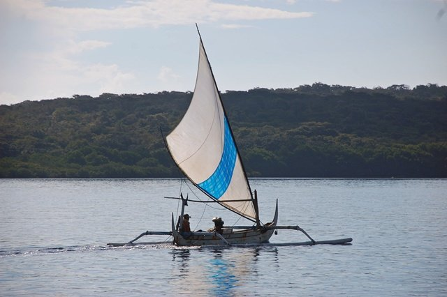 Indonesia outrigger sailing canoe bali fisherman