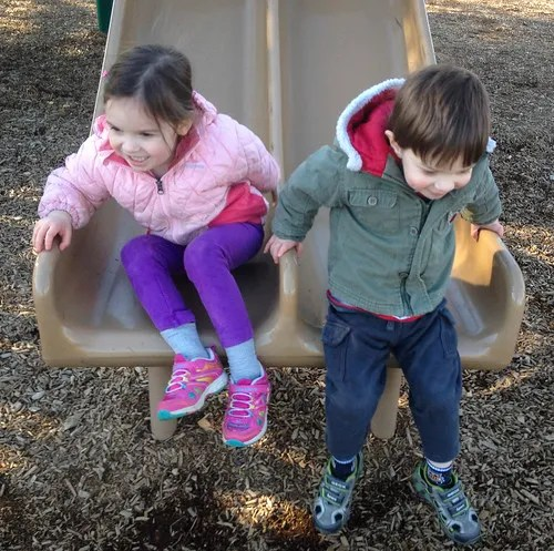 siblings on the slide
