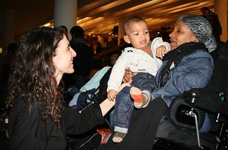 Michelle (in chair) with Martine (kneeling) and her son on Michelle's lap