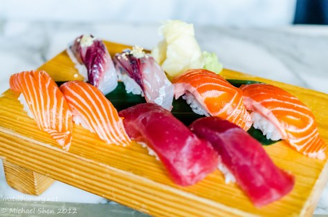 Sushi E Selection of Nigiri (self-chosen in pairs) clockwise from top:  Aji (horse mackerel), shake toro (salmon belly), masu toro (ocean trout belly), maguro (tuna)