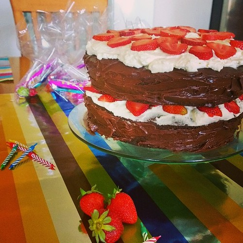 The boy's two-layered birthday cake from yesterday. Yes, those are fresh strawberries and fresh whipped cream but I cheated with the chocolate cake and chocolate ganache (bought & baked a pack). :)