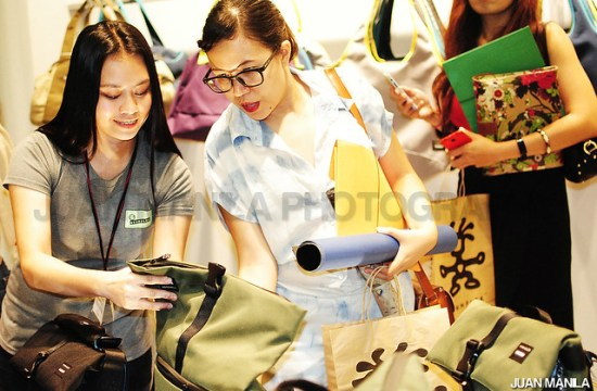 A Crumpler sales personnel shows a bag to one of the early customers.