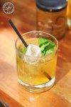 A cold glass of lemon, honey and mint iced tea.