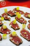 seared venison with horseradish and pear lay thinly sliced on a share platter