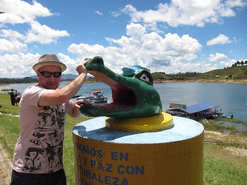Testing my strength against Guatape's viscious alligator garbage can!