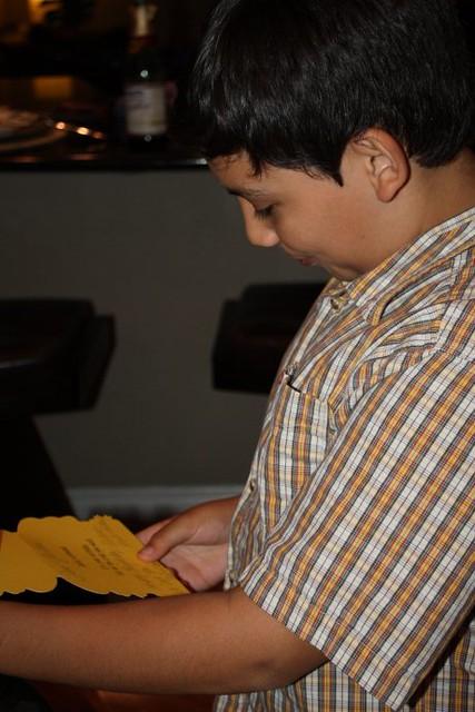 Birthday Boy reading one of his birthday cards