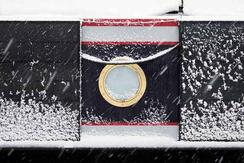 Houseboat window in the snow