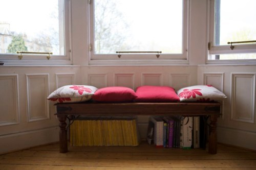 Give awkward spaces a purpose by creating a designated reading area.
