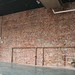 Peckinpah | The back brick wall where the open kitchen line and smoker will be