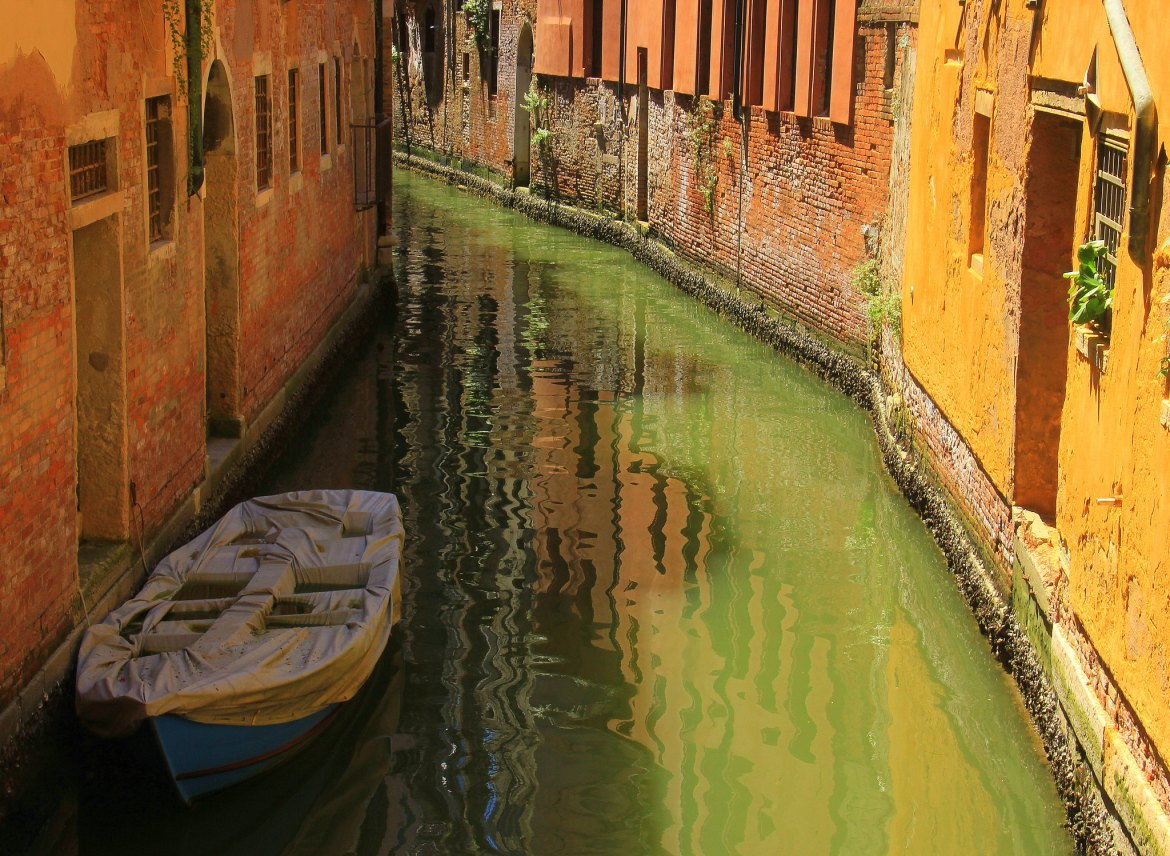 Experience local life in the back canals during your Venice trip