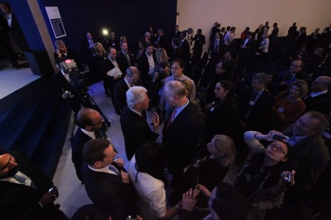 David Gergen has a conversation with Bill Clinton on the floor of the World Economic Forum